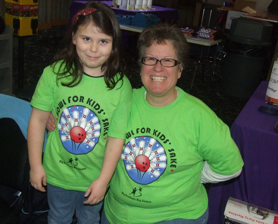 Lilly Friesel (l) and Lori Fetheroff (r) show off the special shirts they wore while participating in the Putnam County Big Brothers/Big Sisters Bowlathon. (Putnam Sentinel/Nancy Kline)