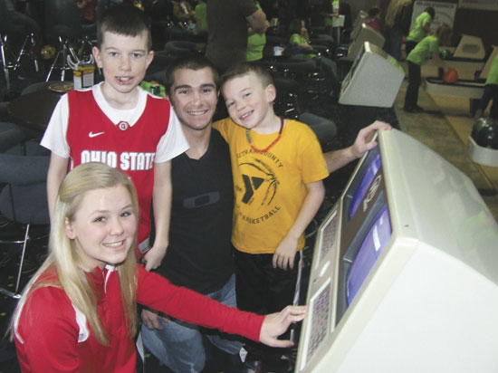 Shana Hovest, Trey Hovest, Hunter Hovest and Tanner Hovest are shown keeping score for their team during the Putnam County Big Brothers/BIg Sisters Bowlathon last Saturday at Ottawa Highland Lanes. (Putnam Sentinel/Nancy Kline)