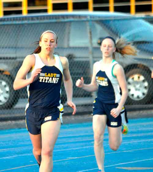 Ottawa-Glandorf's Elissa Ellerbrock and Kelsey Bockrath compete in the 800 meter run at the Bath Ehresman Invitational Friday evening. Ellerbrock won the event and Bockrath was third.