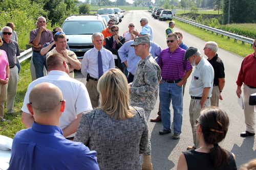 Blanchard River Flood Mitigation Coalition steering committee members and many Putnam County residents joined U.S. Army Corps of Engineers Buffalo District Commander, Lieutenant Colonel Karl Jansen and U.S. Representative Bob Latta (R-OH) on the controversial I-9 bridge on Aug. 7. (Putnam Sentinel/Steven Coburn-Griffis)