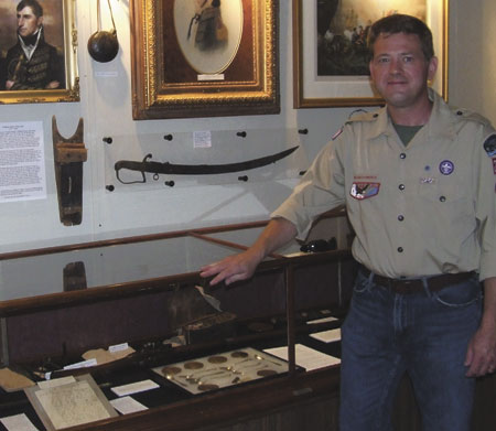 Dr. Wes Klir stands beside an War of 1812 collection that was on display in the Fort Jennings Memorial Hall last weekend. (Putnam Sentinel/Nancy Kline)