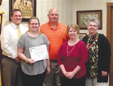 Optmists give character award to two O-G students