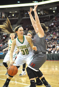 Ottoville's Alexis Thorbahn (30) looks to drive to the basket against this Berlin Hiland player during their Division IV state semi-final game Thursday night. The Hawks defeated the Big Green 44-41. (DHI Media/Charlie Warnimont)