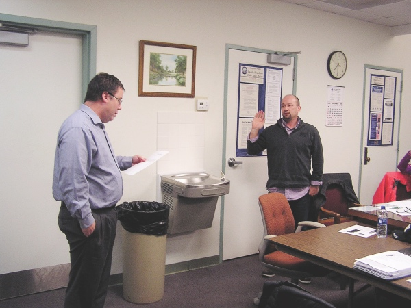 Scott Basinger, solicitor for the Village of Pandora, swears in Jeremy Liechty as Pandora's new mayor. Liechty replaces John Schlumbohm, who resigned the position to assume his new role as a member of the Putnam County Board of Commissioners - Putnam Sentinel