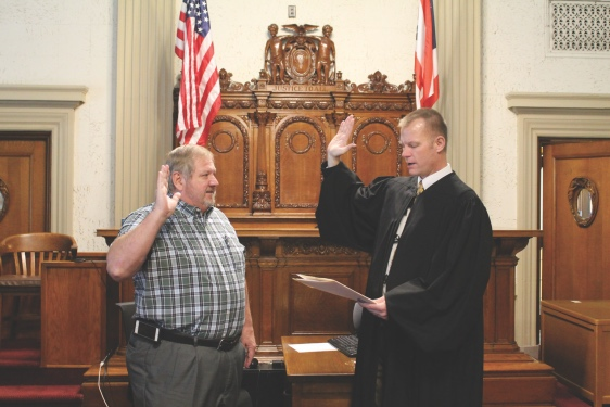 Stan Oren (left) was sworn-in as a new Veterans Service Commissioner just before Christmas by Common Pleas Court Judge Keith Schierloh. He began his five-year term on Jan. 1 - Putnam Sentinel